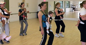 moms and babies swing to the beat of salsa music