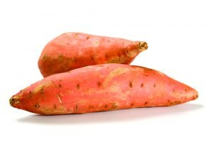 two sweet potatoes isolated on white
