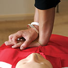 person learning CPR