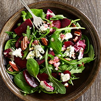 beet salad with greens and nuts