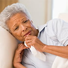 older woman in bed sick