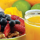 healthy food choices of fruit, granola, yogurt and juice