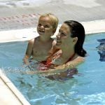Mom and child in swimming pool