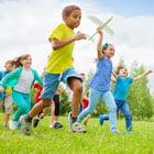 Children running through field
