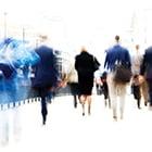 people walking on a busy sidewalk
