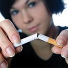 girl breaking a cigarette