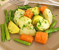 Vegetable pan with green asparagus, carrots, potatoes and german turnip