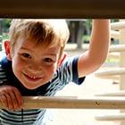 boy playing on playground equipment