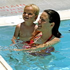 mom and child swimming in a pool