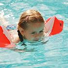 little girl wearing water wings